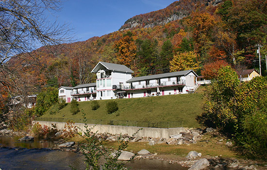 Fall view of the Carter Lodge from the river.